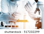 conical flask in scientist hand ... | Shutterstock . vector #517232299