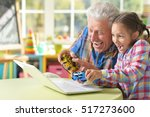 grandfather and granddaughter... | Shutterstock . vector #517273600