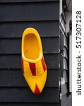 Small photo of Bright yellow wooden clog, traditional Dutch shoes
