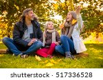 father mother and kid in the... | Shutterstock . vector #517336528