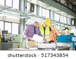 architect and manual worker... | Shutterstock . vector #517343854