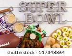 snacks for watching a football... | Shutterstock . vector #517348864