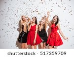 four cheerful beautiful young...   Shutterstock . vector #517359709
