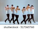 group of men and women dancing... | Shutterstock . vector #517365760