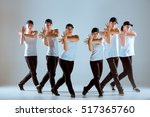 Group Of Men And Women Dancing...