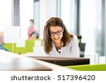 smiling young businesswoman... | Shutterstock . vector #517396420