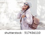 young stylish woman wearing... | Shutterstock . vector #517436110