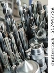 Vertical photo of drills used for milling. - stock photo