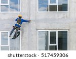 the worker man abseiling with... | Shutterstock . vector #517459306