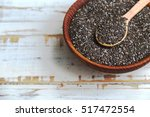 healthy chia seeds in a wooden... | Shutterstock . vector #517472554