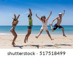 friends fun on the beach under... | Shutterstock . vector #517518499