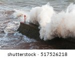 wave crashing over a breakwater ... | Shutterstock . vector #517526218