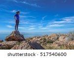 woman on rock looking into... | Shutterstock . vector #517540600