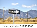 one way road sign with blurred... | Shutterstock . vector #517555063