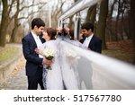 happy couple standing near long ... | Shutterstock . vector #517567780