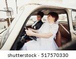 happy bride and groom posing... | Shutterstock . vector #517570330