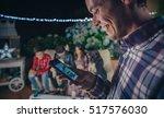 happy man looking smartphone in ... | Shutterstock . vector #517576030