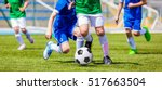 running soccer football players.... | Shutterstock . vector #517663504