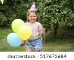 Girl Holding Balloon Happiness...