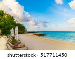 beach chairs with umbrella at... | Shutterstock . vector #517711450