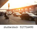 Small photo of Blurred image of cars waiting in LAX Los Angeles international airport arrivals terminal taxi lane, an uber, taxify or lyft pick up location.