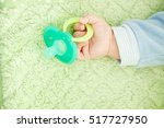 baby's cute little hand and... | Shutterstock . vector #517727950