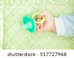 baby's cute little hand and... | Shutterstock . vector #517727968