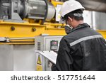 engineers in the back of the... | Shutterstock . vector #517751644