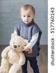 fashion child knitted sweater | Shutterstock . vector #517760143