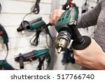 man shopping for drill in... | Shutterstock . vector #517766740
