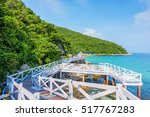 wooden bridge beside sea with... | Shutterstock . vector #517767283