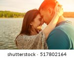 young couple in love outdoors... | Shutterstock . vector #517802164