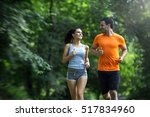 couple jogging and running... | Shutterstock . vector #517834960