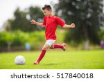 little boy shooting at goal | Shutterstock . vector #517840018