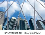 mirrored office buildings | Shutterstock . vector #517882420