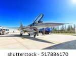 Small photo of KONYA, TURKEY - CIRCA MAY, 2015: Turkish Air Force General Dynamics Lockheed Martin F-16 Fighting Falcon fighter bomber jet aircraft under maintenance with tech staff around panoramic view