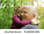 happy kid hugging grandfather... | Shutterstock . vector #518000284