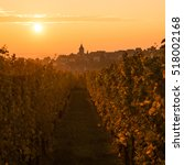 Small photo of The Village of Zellenberg at sunset on the hill with the vineyards on the foreground, Alsace, France