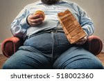 Middle Aged Man Snacking In An...