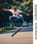 action shot of a skateboarder... | Shutterstock . vector #518020900