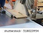 men at work sawing wood.... | Shutterstock . vector #518023954