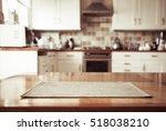 Stock photo blurred kitchen interior and napkin and desk space 518038210