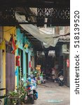 Small photo of Bangkok, Thailand - January 8, 2016: Poor housing with personal transport at the door in Bangkok, Thailand. View of a deserted alleyway.