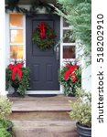 front door with a christmas... | Shutterstock . vector #518202910