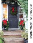 front door with a christmas... | Shutterstock . vector #518202910