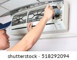 young man adjusting air...   Shutterstock . vector #518292094