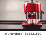 An espresso machine and two cups - stock photo