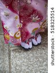 "Small photo of Geisha`s Traditional Sandals ""Geta"" in Fushimi Inari shrine in Kyoto, Japan"