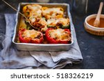 stuffed peppers in a baked pot. ... | Shutterstock . vector #518326219