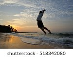 a silhouette on the beach with